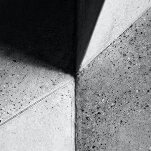 grayscale photo of concrete floor