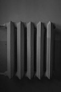 white radiator heater on white wall
