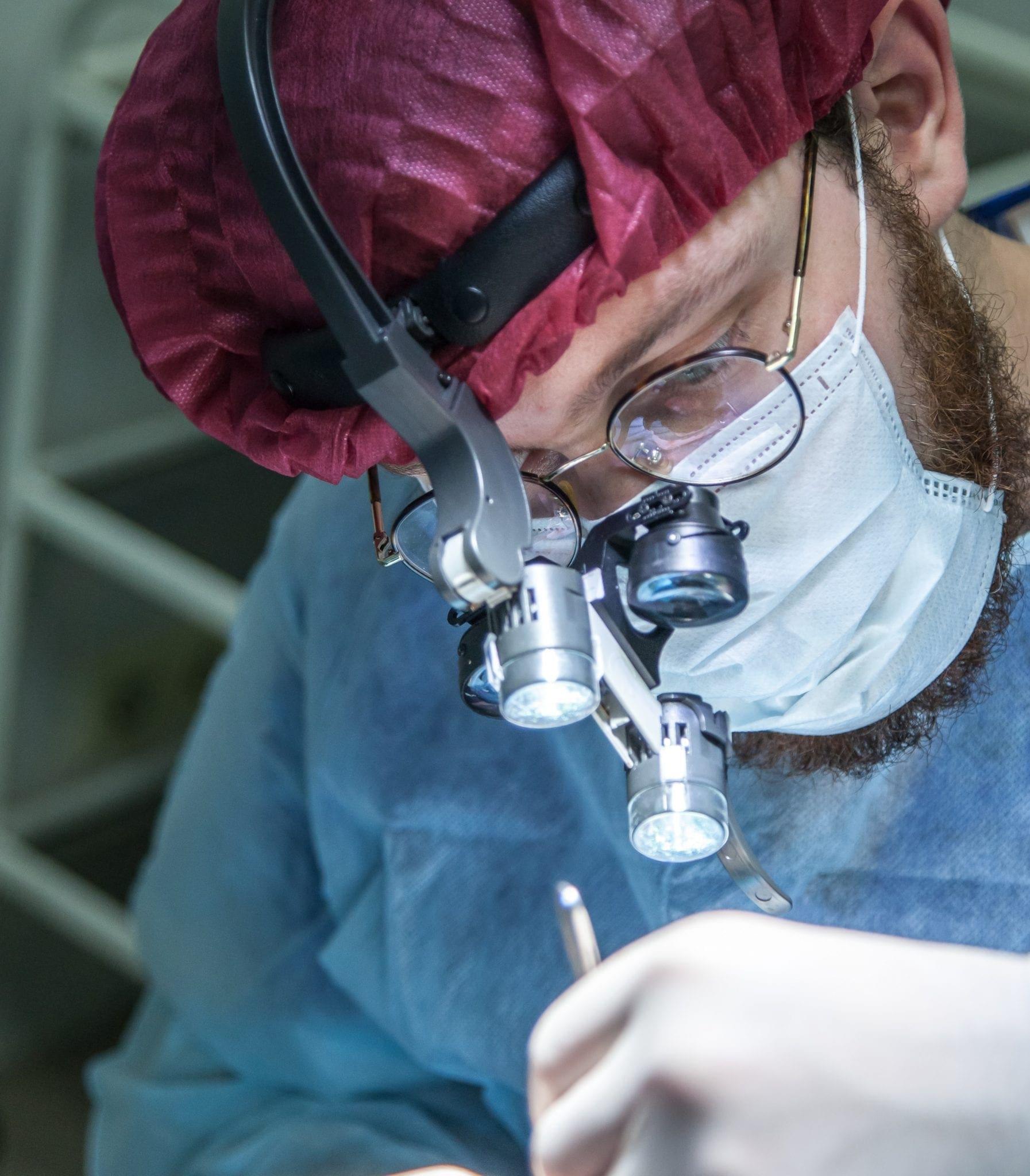 man wearing head microscope